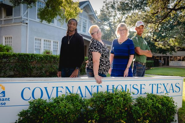 Leslie and youth in front of Covenant House Texas.