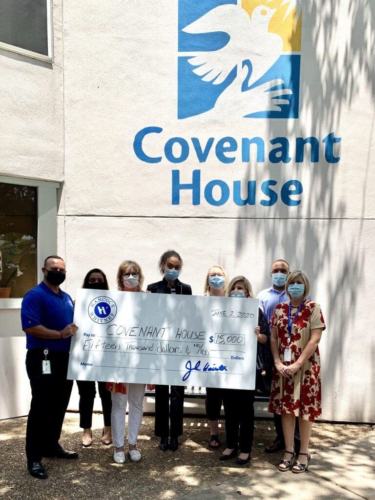 Hancock Whitney staff poses at CHT with $15,000 check